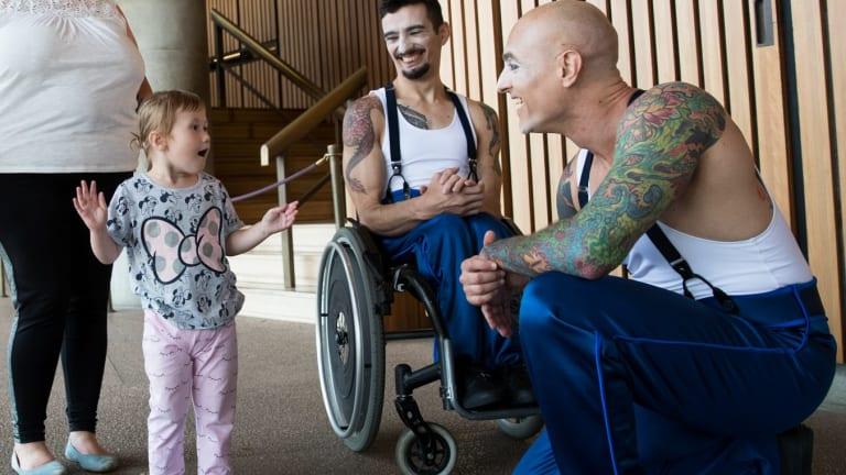 Nevaeh, 2, meets acrobats at the Sydney Opera House.