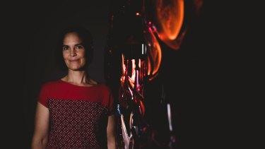 Glass artist Harriet Schwarzrock and her hands on installation between stillness and movement.