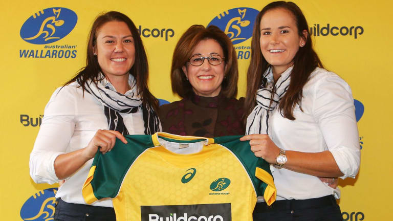 Josephine Sukkar with Wallaroos Sharni Williams and Shannon Parry.