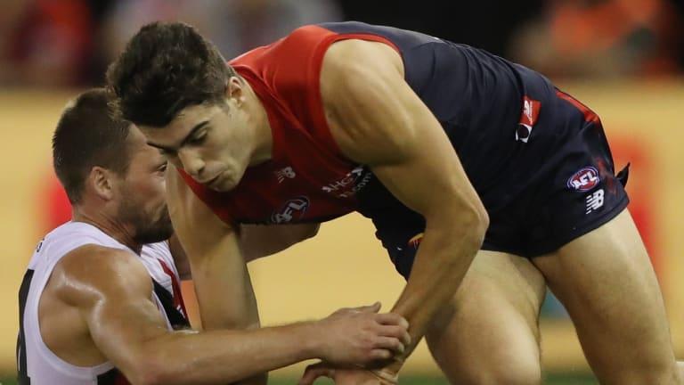 Demon Christian Petracca looks to gather the ball.