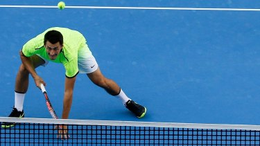 """Tomic on court in the China Open where he played """"very sore""""."""