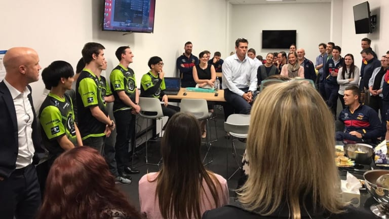 Adelaide CEO Andrew Fagan (centre) and staff, including COO Nigel Smart (far left) meet Legacy eSports team earlier this year.