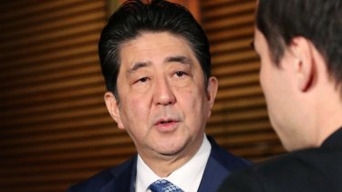 Japanese Prime Minister Shinzo Abe speaks to reporters  on Wednesday. The missile landed in waters off Japan.