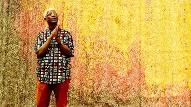 """El Anatsui with his work """"Garden Wall""""."""