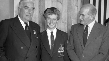 Former prime minister Bob Menzies (right), Olympic champion Betty Cuthbert and William Slim during the 1956 Melbourne Olympics.