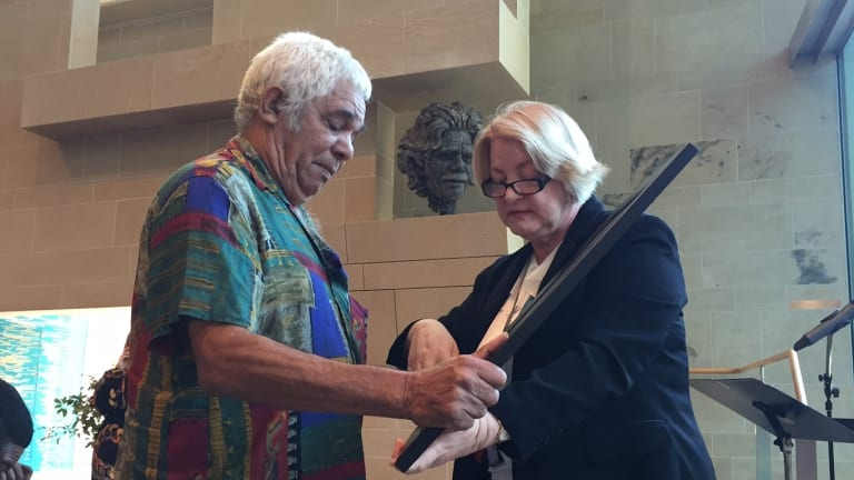 """Neville Bonner's son """"Tiny"""" Bonner with Department of Aboriginal and Torres Strait Islander Partnerships director-general Clare O'Connor."""