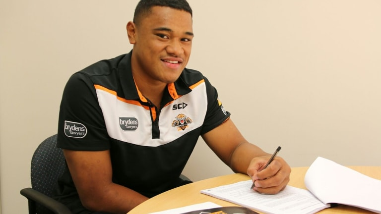Done deal: Mosese Suli signs his $1.3 million contract.