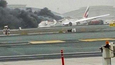 An Emirates plane caught fire after making a crash-landing at Dubai airport.