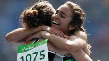 Respect: Abbey D'Agostino, right, hugs Nikki Hamblin.