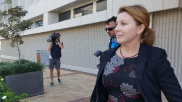 Amber Heard's lawyer Paula Morreau leaves Southport court.