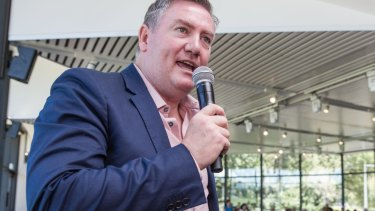 Eddie McGuire has called for those behind the anti-Muslim banner to be banned for life.