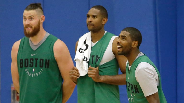 Aron Baynes (left) with Celtics teammates Al Horford and Kyrie Irving.