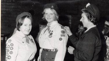 Jenny James receives her Queen's Guide badge in 1975 from Woden Valley Commissioner for Guides Shirley McLennan.