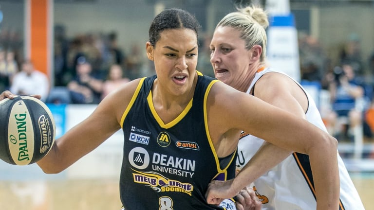 Liz Cambage makes a path to the basket against Fire's Suzi Batkovic.