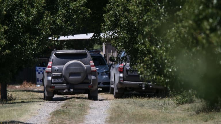 Police arrive at Karen Chetcuti's house on Saturday.