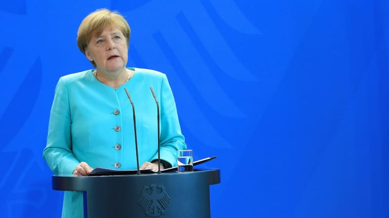 Angela Merkel cut short her time off and got back to work after a spate of attacks nationwide.