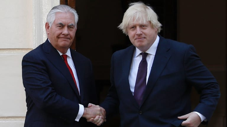 Britain's Foreign Secretary Boris Johnson, right, greets US Secretary of State, Rex Tillerson in London on May 26.