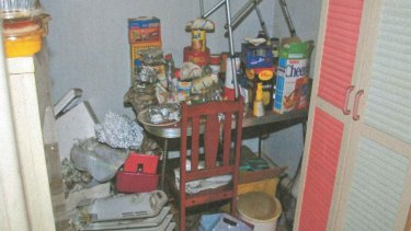 Food and clutter in the kitchen of the deceased Blackburn North woman.