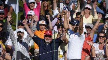 Hot streak: Adam Scott celebrates after sinking a long putt on the 18th.