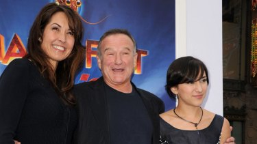 Robin with his wife, Susan, and daughter, Zelda Williams at the  premiere of <i>Happy Feet Two</i> in 2011.