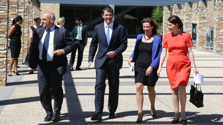NSW Premier Mike Baird, centre, with Maitland candidate Steve Thomson, Newcastle candidate Karen Howard and Transport Minister Gladys Berejiklian in Newcastle on Tuesday.