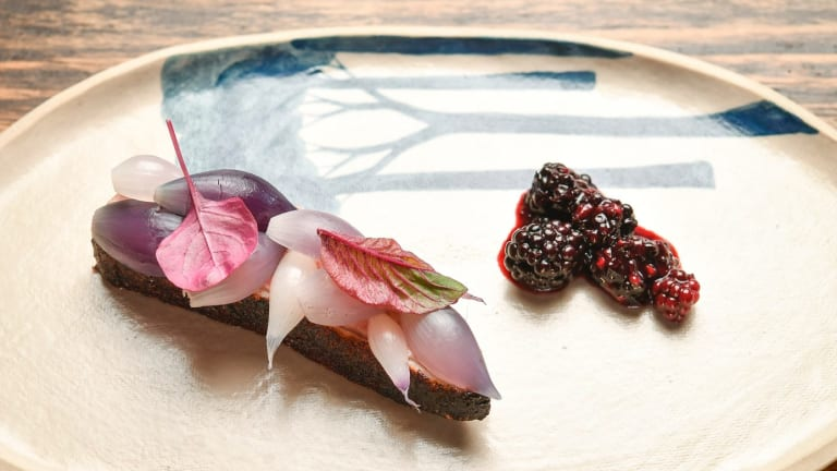 Dry-aged duck with blackberries and amaranth.