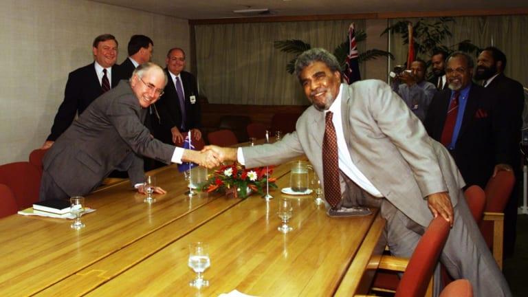 Mr Morauta meeting then prime minister John Howard in Port Moresby.