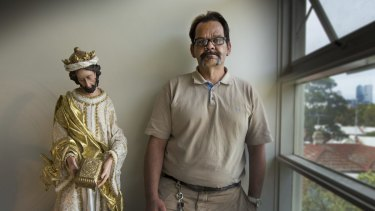 Jason Russell at home with his Jesus statue, which he says played a part in his recovery.