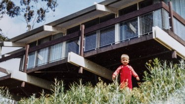 Photograph of Alan as a child, in the backyard of their home.
