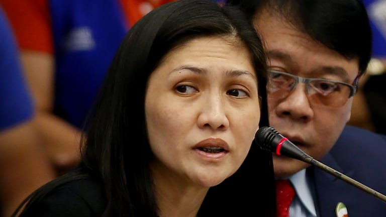 Bank manager Maia S. Deguito testifies before the Philippine Senate Blue Ribbon Committee probe into how $81 million of Bangladesh's stolen funds were transmitted online to four private accounts.