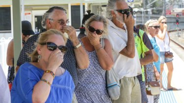 Local residents try to block the smell emitting while waiting for a train at Mulgrove Station