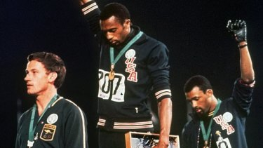 Iconic protest: But Peter Norman, Tommie Smith and John Carlos were shunned after their stand at the 1968 Olympics.