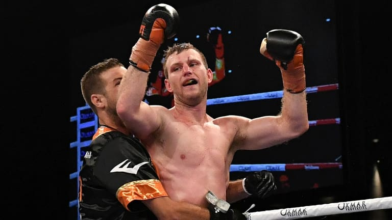 Hornet stings: Jeff Horn celebrates after successfully defending his WBO world welterweight champion title against UK boxer Gary Corcoran.