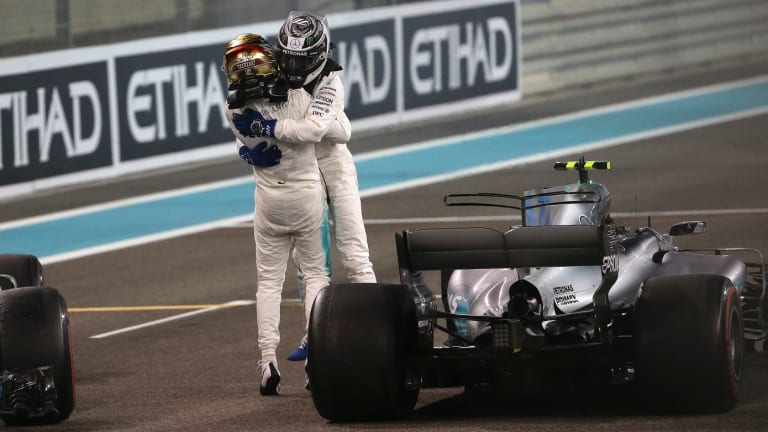 Mercedes drivers Valtteri Bottas and Lewis Hamilton embrace after finishing one-two in Abu Dhabi.