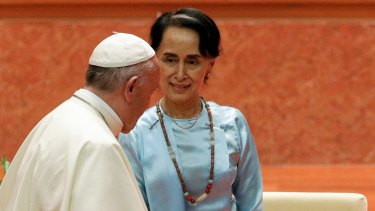 Pope Francis walks past Myanmar leader Aung San Suu Kyi during their meeting at the International Convention Centre of Naypyitaw, Myanmar.