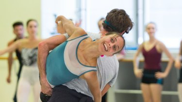 Dimity Azoury being lifted by Rudy Hawkes during rehearsals for DGV.