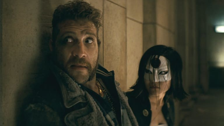 Jai Courtney as Captain Boomerang and Karen Fukuhara as Katana in Suicide Squad.