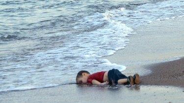 The lifeless body of Aylan Kurdi lies on a Turkish beach.