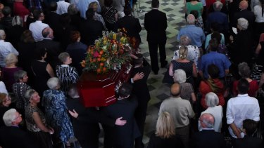The casket of Faith Bandler arrives in The Great Hall at Sydney University.