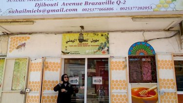 Afrah Suhail stands outside her shop near the bustling central market of Djibouti's capital.