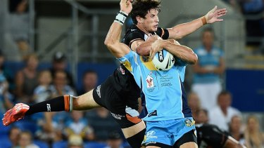 Clothesline: Mitchell Moses catches William Zillman high in a combustible moment at Robina.