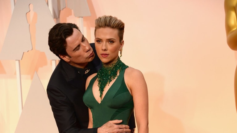 John Travolta and Scarlett Johansson's awkward picture on the Oscars 2015 red carpet.