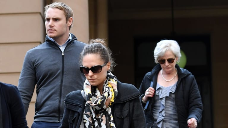 Adam Cranston's wife, Elizabeth (centre), mother Robyn (right) and brother Josh leave Sydney Central Local Court on Thursday.