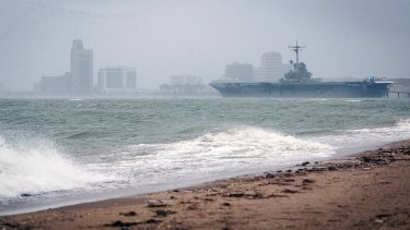 The USS Lexington, an aircraft carrier turned museum, rests in Corpus Christi Bay as waters begin to turn rough around Corpus Christi, Texas.