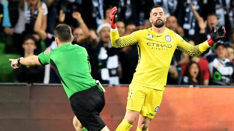 Blunder: Bouzanis reacts after referee Jarred Gillett awards the spot kick.