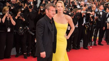 Before the big freeze: Sean Penn and Charlize Theron appear together in Cannes.