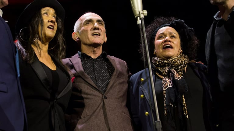 Paul Kelly (centre) with the Bull sisters, whom he met via Archie Roach.