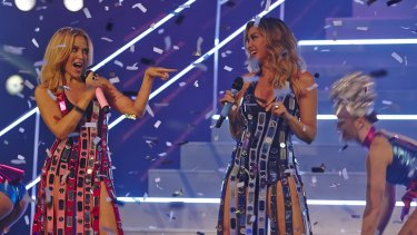 Kylie and Dannii Minogue perform on <i>The X Factor</i>.