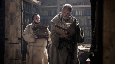 Sam (John Bradley) and the Archmaester (Jim Broadbent) gather some light holiday reading for the beach.