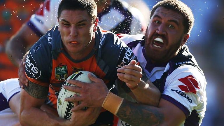 Parramatta bound: Wests Tigers star Mitch Moses (left).